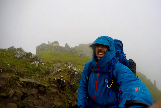 Tom Young in the rain on a mountain
