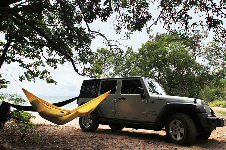 DD SuperLight Hammock in sandstorm yellow with a 4x4