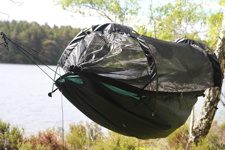 DD SuperLight Jungle Hammock with mosquito net by a highland loch