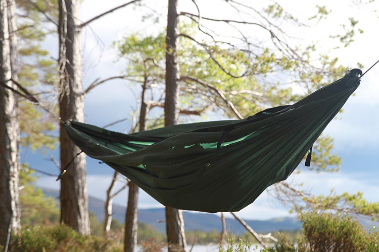 DD SuperLight Jungle Hammock by a loch with base layers only