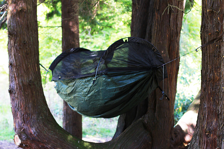 DD SuperLight Jungle Hammock with mosquito net in the woods