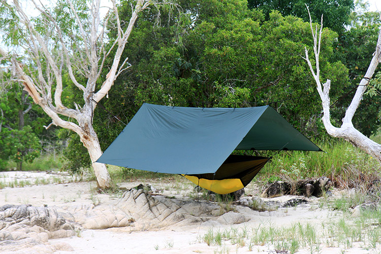DD Superlight Tarp set up with Superlight Hammock and mosquito net on the beach