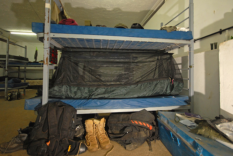DD Travel Hammock / bivi on a bed with mosquito net