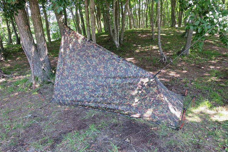 DD Tarp 3x3 multicam used as a tent in the woods