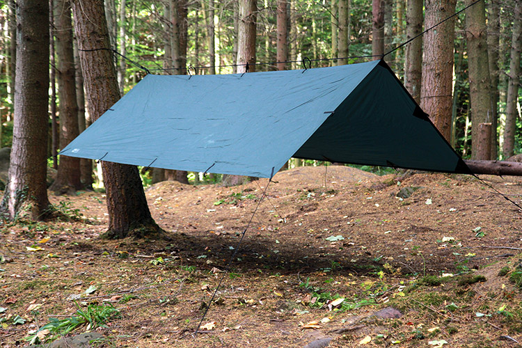 DD Tarp M in olive green set up outdoors as an a-frame