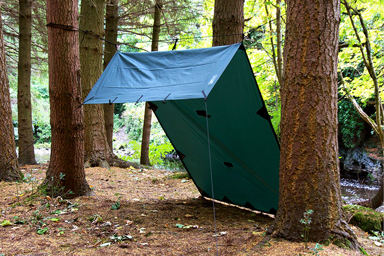 DD Tarp S olive green set up outdoors in lean-to formation