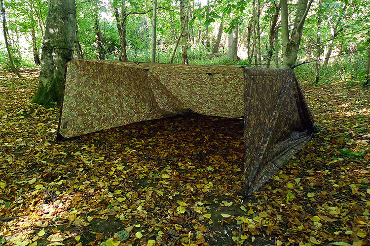 DD Tarp XL in multicam set up as a ground shelter outdoors